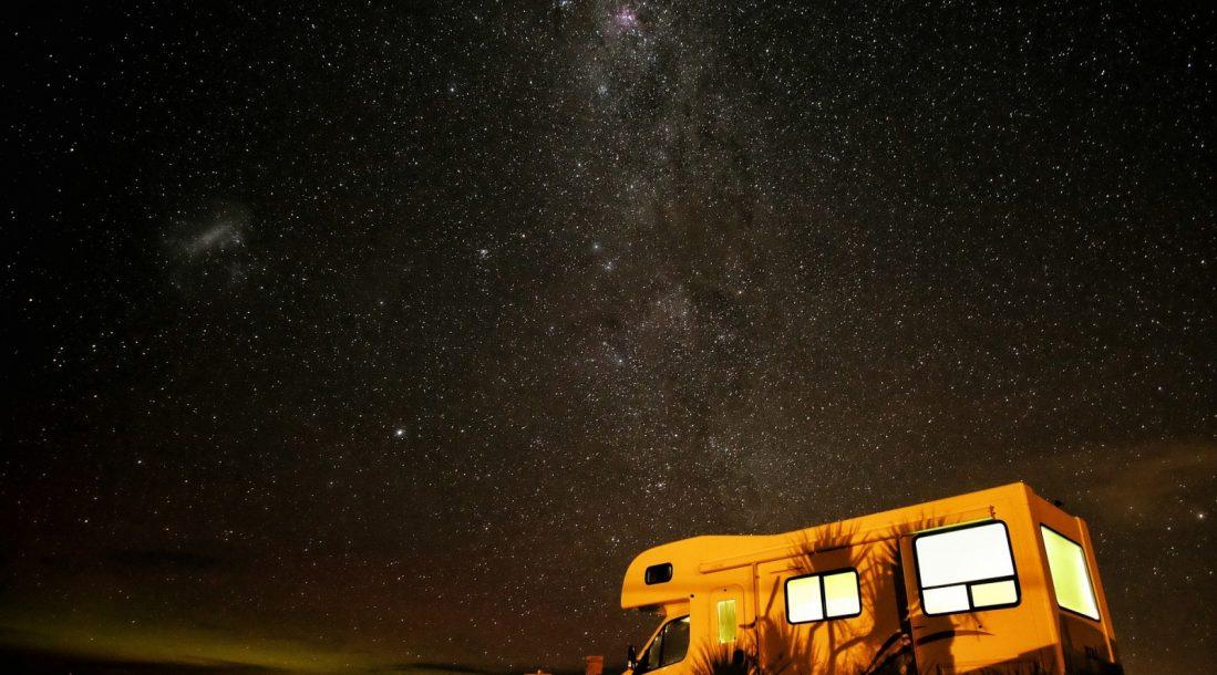 camper under stars